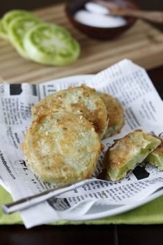 Fried green tomatoes.  Yes, yummy.  I don't know what the frying does to them, but I wouldn't eat them any other way.