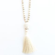 """Gorgeous 8mm riverstone gemstone beads and a white turquoise Buddha with a silky luxe tassel make up this gorgeous, wear-everywhere necklace. Hangs approx. 35"""". Tassel is approx. 3.5"""". Signature tag. Seaside single tassel necklace sold separately here: http://tenthingsjewelry.bigcartel.com/product/tenthings-seaside-gemstone-tassel-necklace-n-a1aI hand-pick all my materials and make each piece myself in my studio in San Diego. The artisan wood beads are cut, turned ..."""