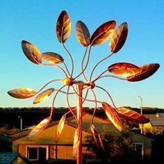 Kinetic Sculptures are garden art that moves with the wind.