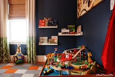 5 discovery adventure toddler bedroom - train table and reading nook