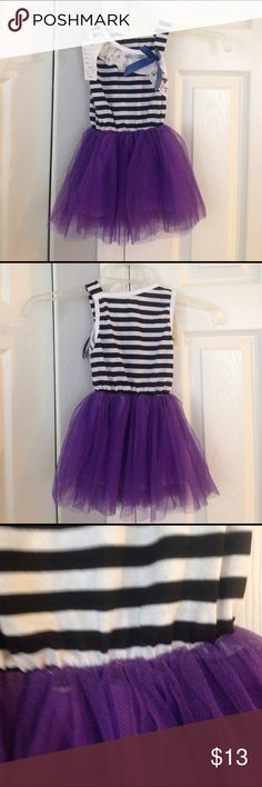 New Adorable 12-18 month dress 100% Brand New, the dress is a second, please see pic 3 & 4. Tulle is not seen on straight. It's still an adorable dress. Size 12-18 months Material: Cotton + Tulle +Lace. Color: Purple, navy and white Size:T ( 12-18 Months). Package Includes: 1 X Dress . Girls dress, sleeveless, comfy and cool to wear with Raw edge hem. Dresses Casual