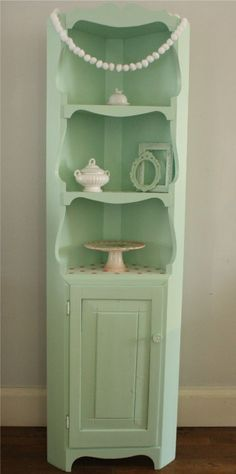 Everything You Do is A Balloon. Mint green 50s kitchen inspired corner cabinet