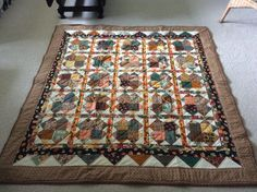 I put every Fall fabric I could find into this quilt.  Made by Sharon Theriault