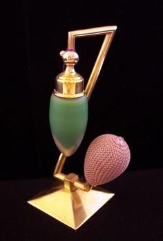 VINTAGE DEVILBISS PERFUME ATOMIZER. It has very Art Deco stylingto it with the stand being very angular and offset. The bottle is frosted and green cased glass.The glass siphon tube is fully intact.