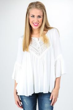 Hello Gorgeous! The perfect Spring blouse with bell sleeves and lace detail! Want, need, love!