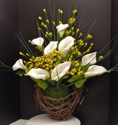 Spring 2014 Season Oval Grape Vine Bird's Nest Wreath with Moss Sphere and Calla Lilies. Design and arrangement by http://nfmdesign.synthasite.com/