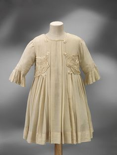 An adorable little girl's silk party dress made in England circa 1890. This particular dress shows heavy influence from the Arts and Crafts Movement of the late 19th century.