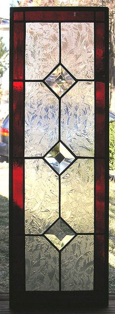Red and Clear Textured--6.5 x 18.5--Stained Glass Window Transom Panel This original design includes three square 1.5 bevels spaced in the center of the design surrounded by clear textured Glue Chip glass, then bordered by red cathedral glass. It has a zinc frame surrounding the