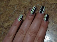 White and black manicure with green stripes !! Cute nail design !