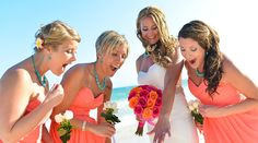 Bride and bridesmaids check out the ring in this beach bridal party portrait. Love the pink bridesmaid dresses and turquoise jewelry! | Palace Resorts Weddings ®
