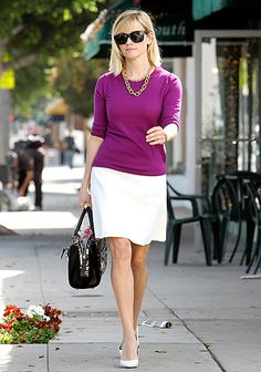 Reese Witherspoon was on the move in a bright purple sweater paired with a white skirt and matching heels. A gold necklace gave the outfit luxe appeal.