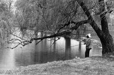 A visitor tries to catch dinner on Belle Isle in 1982. ((The Detroit News)/)    From The Detroit News: http://www.detroitnews.com/article/20120724/METRO01/207240419#ixzz23jIkh8Z1