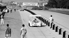 Jim Hall brings his Chaparral 2G into the pits from practice for the 1968 Road America Can-Am. Head Mechanic, Franz Weis, stands by in the foreground. Al Bochroch photo.