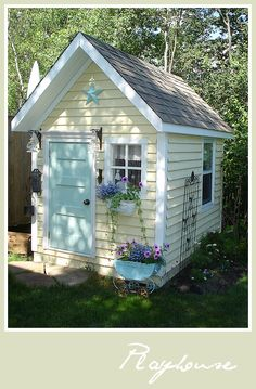 Play house, garden shed, craft room?  Love this little house.