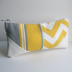 The summer brings beautiful rays of yellow captured beautiful in this mixed-print clutch.