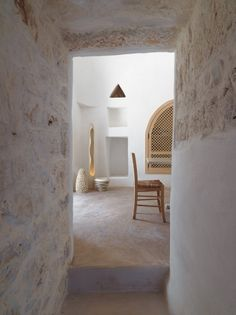 Lime plastered walls, built in shelving & cabinets, tadelakt style floors, minimal style, quirky triangle in wall too?