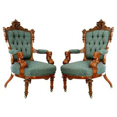 Fantastic pair of antique 19th carved figural parlor armchairs executed in rosewood. These large parlor chairs have carved classical maidens on the arms, figural crests with drop finials and turned front legs.