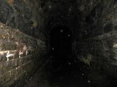 The Screaming Tunnel;Niagara Falls, Ontario, Canada - A local legend recounts that the tunnel is haunted by the ghost of a young girl, who after escaping a nearby burning farm building with her clothing ablaze, died within its walls. Several variants of the legend exist locally. The tunnel was used as a set during the filming of David Cronenberg's 1983 film adaptation of Stephen King's horror novel The Dead Zone.