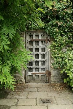Garden gate with rivets. Together with the trellis pattern it creates a medieval style. what's behind it?