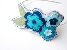 Etsy の Embroidered Hair Band by SewSweetStitches