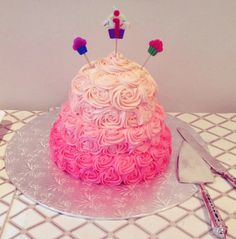 3 tier Pink Ombre Vanilla Cake with Raspberry Jam filling topped with Buttercream icing!