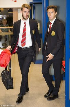 De Gea walks alongside new United defender, Italian Matteo Darmian...