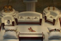 Jewelry display idea. Couches and arm chairs.