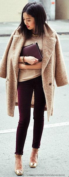 Shop this look on Lookastic:  http://lookastic.com/women/looks/pumps-skinny-jeans-coat-crew-neck-t-shirt-bracelet-clutch-necklace/8409  — Tan Leather Pumps  — Burgundy Skinny Jeans  — Camel Coat  — Tan Crew-neck T-shirt  — Gold Bracelet  — Burgundy Leather Clutch  — Gold Necklace
