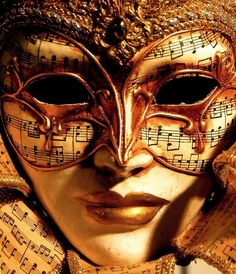I have a similar mask that we bought in Venice. The combination of mask and music is a great pairing.