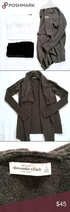 A&F Asymmetrical Cardigan Abercrombie & Fitch asymmetrical cozy Cardigan! Perfect to wear with leggings!! Feel free to ask questions and bundle for best savings! Reasonable offers are considered, no trades please.  Shop on and Happy Holidays Y'all!! 🥂🍾🎉🍾🥂 Abercrombie & Fitch Sweaters Cardigans