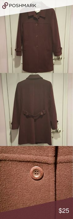 """Nine West Wool Coat Nine West wool walking coat in a beautiful aubergine color (slighly more purple than in pics). I'm 5'8"""" and it hits me about 6"""" below my fingertips. Slightly shaped through the body. Fpur buttons up and two slash pockets on the front.   Used for one season. Still in good condition. Did wear once since dry cleaned, but no stains or marks outside/inside.  100% wool. 100% polyester lining. Dry clean.   Approx 35.5"""" long, 29"""" sleeve length, 19"""" across bust Nine West Jackets…"""