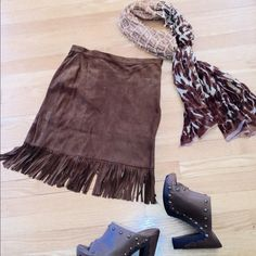 Short Brown Suede Fringe Skirt Sexy short suede fringed skirt. Fully lined with side zipper. Made in Italy size 42 but would fit more like a 2-4. Skirts A-Line or Full