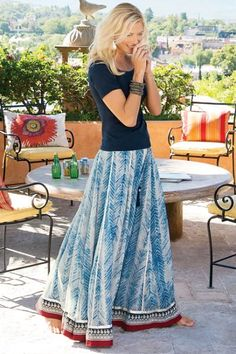 """Designed for dancing, our gorgeous georgette skirt has a pull-on smocked elastic waist and beaded tassel drawstring atop a strikingly stylized indigo print. Bordered with metallic embroidery and ribbon. Fully lined. Viscose; cotton. Misses 38"""" long. Sits just below natural waist.Zagara Skirt #28652"""