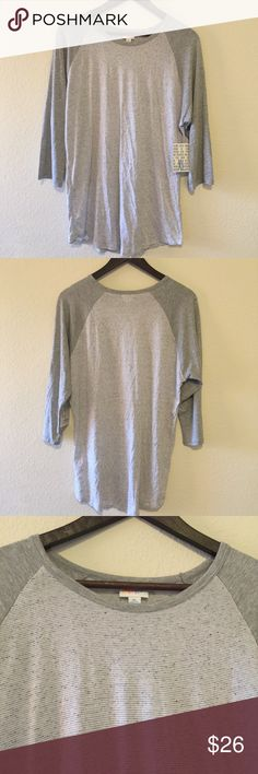 NWT Lularoe Randy Shirt XL NWT grey Randy from Lularoe. It has dark grey sleeves and a light grey and white striped body, with a hint of blue. I bought this is the wrong size, so sadly it doesn't fit me... Make an offer if interested! ✨ I have 2 other NWT Randy's in my closet available! ✨ LuLaRoe Tops