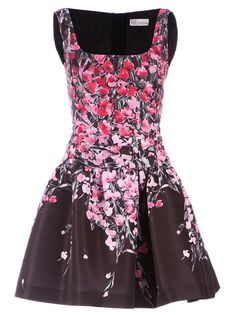 Brown sleeveless dress from Red Valentino featuring a square neckline, a dropped waist, a rear zip fastening, a flared skirt and a pink and red floral design on the bodice and skirt.