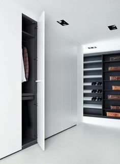 Modern Walk in Closet// White sleek doors, recessed lighting//
