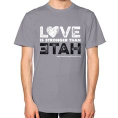 LOVE is stronger than hate Unisex T-Shirt (on man)