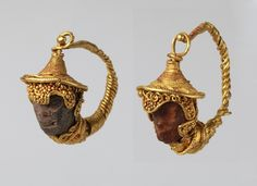 Gold and amber earrings with head of a black youth, Hellanistic period, Etruscan, circa 200-100 BC