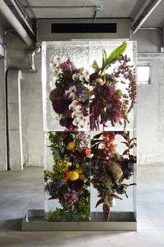 Azuma Makoto's floral arrangements suspended in blocks of ice | frozen flower sculptures.