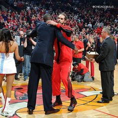 Kia NBA Defensive Player of the Year Joakim Noah embraces four-time award winner Dikembe Mutombo just after the pregame presentation.