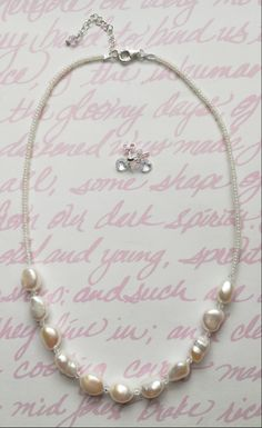 Flower girl necklace + earring set.  Freshwater pearls, sterling silver, + Swarovski crystals.  Perfectly delicate and dainty for a young girl.  Custom jewelry. www.aebumble.com