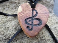 Hand carved guitar pic necklace- with an added wood burned G Clef  Chris Yucatonis Artist