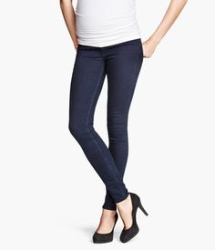 DESCRIPTION Treggings in stretch denim with mock fly at front and pockets at back. Wide ribbing at waist for added comfort.