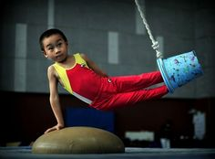 A child takes part in a gymnastics training session at Fuzhou Sports School in Fuzhou, China. Picture: China Foto Press / Barcroft Media