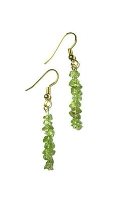 "Genuine untreated glowing green peridot mini chips on gold plated earwires. 2"" long from top to bottom, 1/3"" wide.    Peridot is the birthstone for the month of August. Cleopatra was known to have worn peridot. Peridot is also thought to protect its wearer from the evil eye. by SplendidStones on Etsy, $18.00"