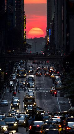 Manhattan-henge - twice a year, (In May and July) the sunset is exactly aligned with the grid of the streets in Manhattan.