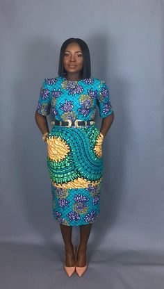 Turquoise mixed print classic fitted dress .Very flattering slim fit Ankara African print dress for that elegant look Made from 100% authentic holland wax print Fitted cobalt blue African wax print dress fits below the knee and perfect dress for that special occasion! Fully lined and