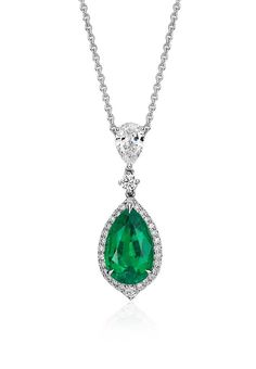 This one-of-a-kind gemstone and drop diamond pendant showcases a vibrant 2.71 carat emerald surrounded by pavé-set diamonds set in 18k white gold.