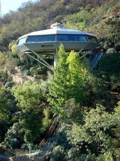 """""""Chemosphere""""1960, by American architect John Lautner for Malin Lautner, a young aircraft engineer. It was an engineering feat due to location on a 45 degree slope in an earthquake zone. The house hovers 30 feet over the city of L.A. & resembles a UFO aircraft. Steel struts shoot out from the single column to support the floor. The inside is a column-free open space. The structure is made of steel & timber, & the roof is supported by curved frames of laminated wood~ ©Sara Sackner / Arch…"""