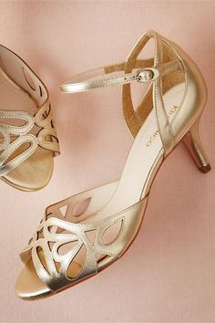 Lattice-sliced champagne leather gives these heels a soft look that goes beyond the wedding day, while the low heel and ankle strap lend them to stepping out on the dance floor.